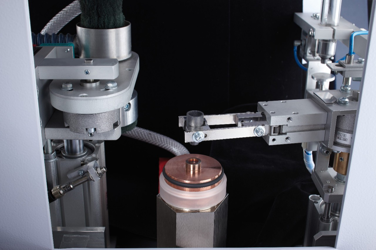 Automated crucible handling with electrode cleaning