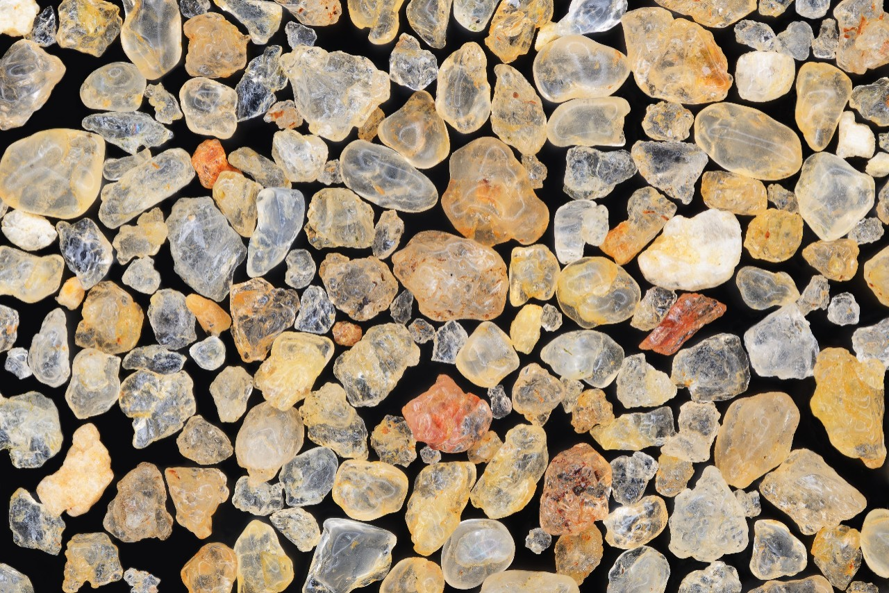 Extreme close-up of sand grains. Isla Grande, Brazil.